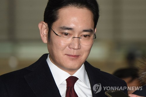 Samsung heir returns home after being grilled in corruption probe