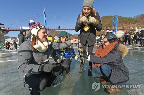 Hwacheon Sancheoneo trout fest sees 100,000th foreign visitor for first time