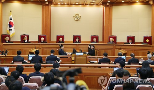 Man ordered to leave Park's impeachment hearing after clapping