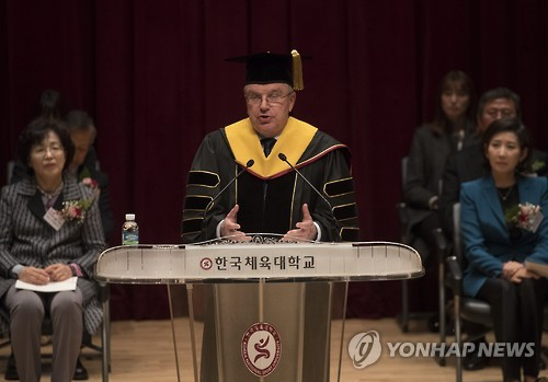 IOC President Bach receives honorary degree at nat'l sports university