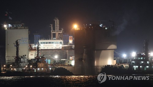 Sewol ferry safely placed on semisubmersible ship