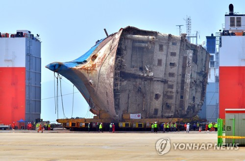 S. Korea moves salvaged ferry onto land