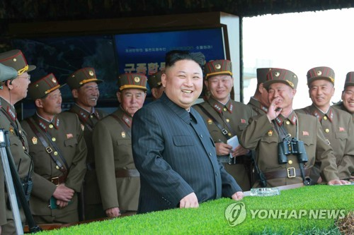 N.K. leader watches live-fire drill on military anniversary