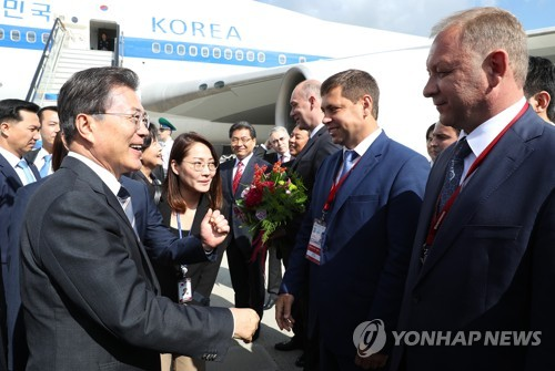 S. Korean President Moon arrives in Russia for summit with Putin, regional forum