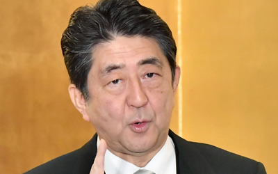 Abe rejects S. Korea's latest stance on sex slavery deal