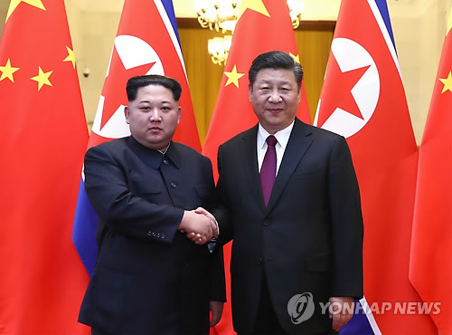 Kim reaffirms commitment to denuclearization in first summit with Xi