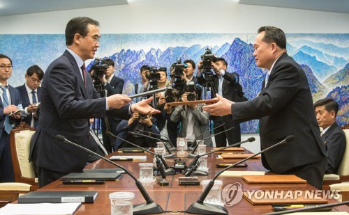 Koreas agree to hold military dialogue, family reunion talks this month
