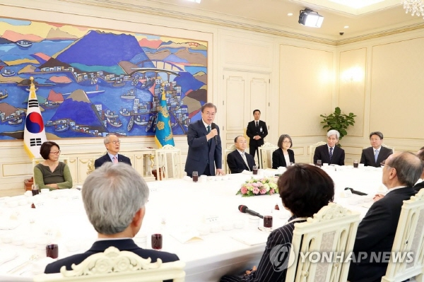 Moon voices concern about political rifts, vows efforts for talks with critics