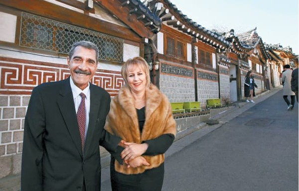 Ambassador Mohammed El Amine Derragui of the People's Democratic  of Algeria in Seoul posing for the camera in front of traditional Korean houses at the Hanok Maul Village in Seoul.