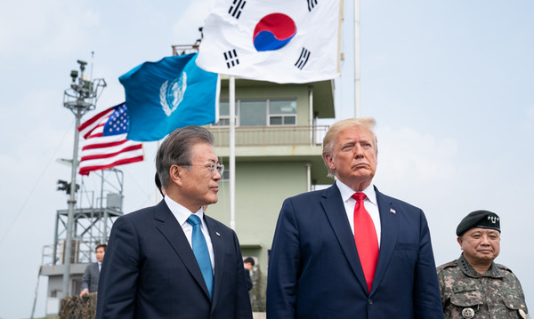 "President Moon Jae-in and U.S. President Donald Trump are shown here on June 30 visiting an observation post in the Demilitarized Zone separating the two Koreas. The U.S. State Department on July 2 said both leaders reaffirmed the ""ironclad"" alliance of their two countries. (White House)"