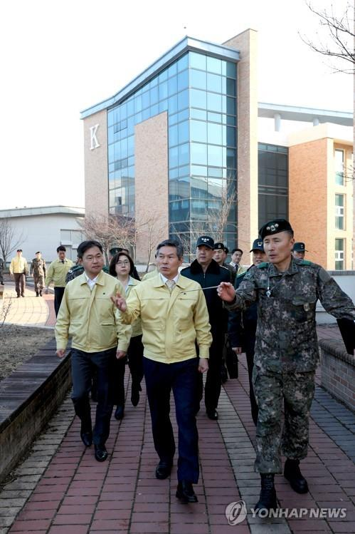 Defense Minister Jeong Kyeong-doo (C) looks over the Korea Defense Language Institute in Icheon, 80 kilometers southeast of Seoul, on Feb. 20, 2020, which will house the third group of South Korean residents and their Chinese family members who will be airlifted to South Korea, in this photo provided by his office.