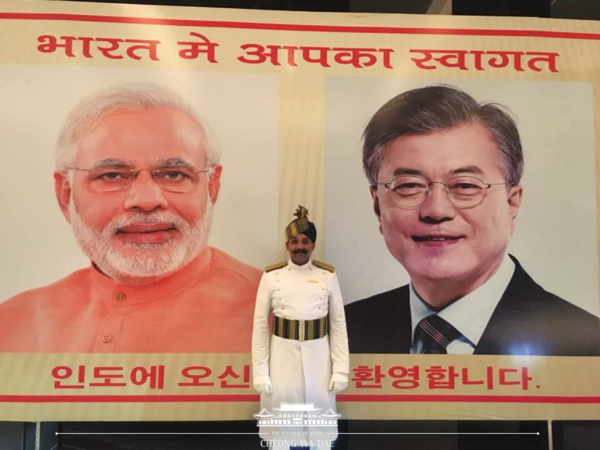 "This large picture of President Moon (right) and Prime Minister Modi was hoisted in front of the lobby of the hotel where Moon and the Presidential entrage stayed during their visit to India. A sign reading in Hangeul Korean alphanet reads: ""Welcome President to India!"""