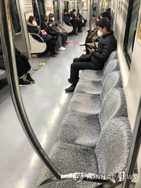 Only a few passengers ride a subway in the southeastern city of Daegu on Feb. 21, 2020, amid the spread of the new coronavirus. (Yonhap)