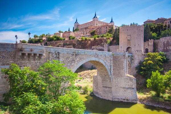 Alcazar and Alcantara Bridge in Toledo, Spain.