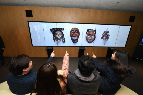 Visitors exploring the digital content of the cultural heritage at the National Palace Museum in Sejong-ro, Seoul.