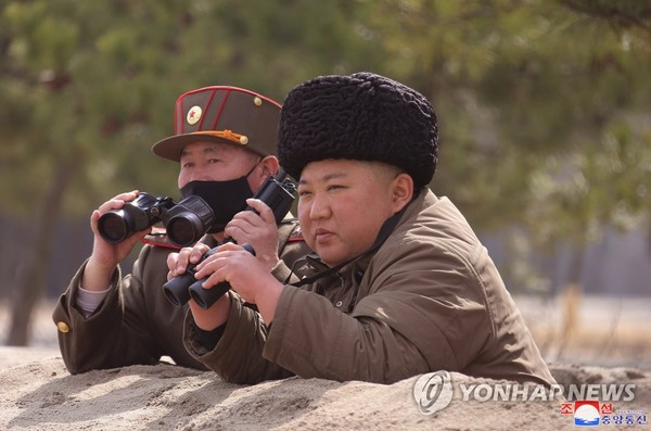 This photo disclosed by the Korean Central News Agency on March 10, 2020, shows Kim Jong-un watching a long-range artillery strike drill. (For Use Only in the Republic of Korea. No Redistribution) (Yonhap)