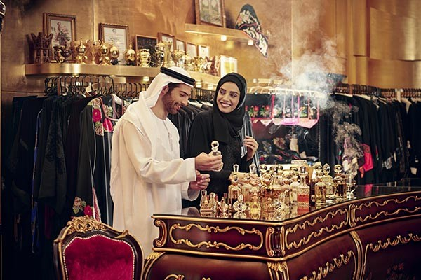 Dubai is the one of the famous markets for perfume. Photo shows people checking perfume at a store.