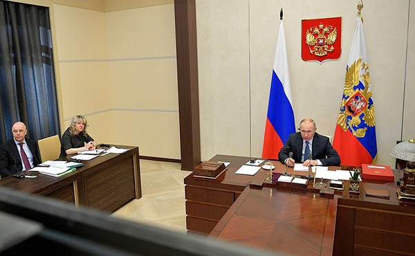 The President (right) takes part in the Extraordinary Virtual G20 Leaders' Summit. With Finance Minister Anton Siluanov (left) and Representative of the President of the Russian Federation in the G20 (Russia's G20 Sherpa) Svetlana Lukas.