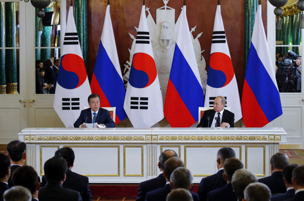 President Moon Jae-in (left) speaking with President Vladimir Putin of Russia in Moscow.