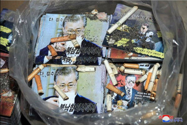 North Korean leaflets showing President Moon Jae-in dumped with cigarett buts