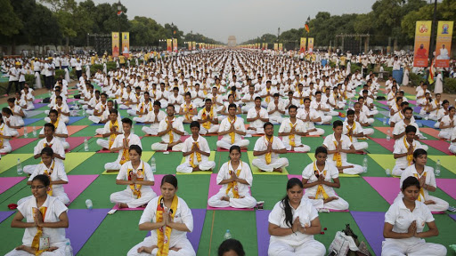 A group of women practicing Yoga in India.