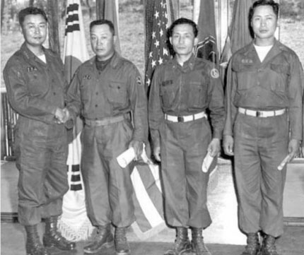 Paik Sun-yup, commander of the 1st Republic of Korea Army (far left), is seen with the then Major General Park Chung-hee (third from left). Major Gen. Park (later President of the Repulic of Korea) was rescued by Paik when Park faced charges of collaboration with Communist North Korea.