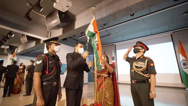 Ambassador Ranganathan of India (third from left, foreground) and Defense attaches salute to the Flag of India on the National Day of India.