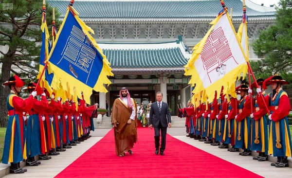 President Moon and Crown Prince Salman of Saudi Arabia (right and left) review the traditional Korean military honor guards at the Presidential Mansion of Cheong Wa Dae in Seoul.
