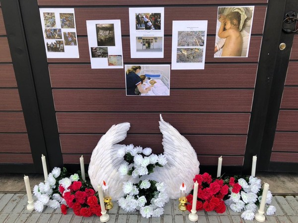 Condolence flowers and pictures of the victims from Armenian attacks placed in front of the Azerbaijan Embassy in Seoul