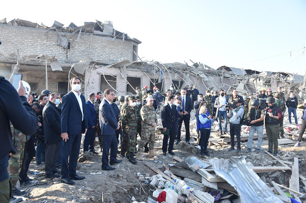 Azerbaijan government officials inspecting the damages in their country.