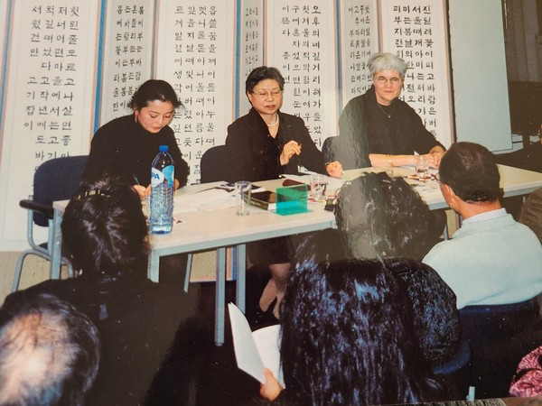 Novelist Han (center) attends a reading event for her novels at the Korean Cultural Center in Berlin, Germany in November 2004.