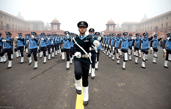 Anothr view of the Republic Day of India parade particiants clad in black uniform under blue shirts with white foot gaiters.