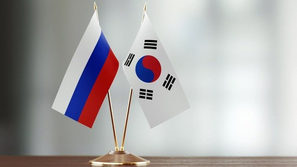 ​Russian and Korean flags​