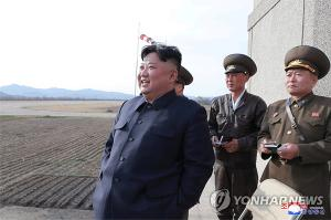 N.K. leader supervises test-fire of new tactical guided weapon: KCNA