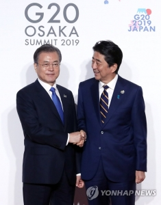 Moon extends sympathy to Abe over typhoon damages